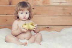 Boy eating apples Royalty Free Stock Photos
