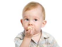 Boy eating banana stock image