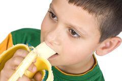 Boy eating banana Stock Image