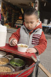 Boy eating Bean Curd Pudding Royalty Free Stock Photo