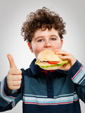 Boy eating big sandwich Royalty Free Stock Images