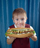 Boy eating big sandwiches Stock Photo