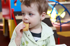 Boy eating biscuit Royalty Free Stock Photography
