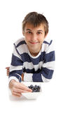 Boy Eating Blueberries Stock Photography