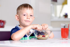 Boy Eating Bowl of Cereal for Breakfast Stock Photography