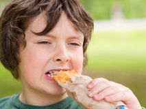 Boy eating bread Stock Photography