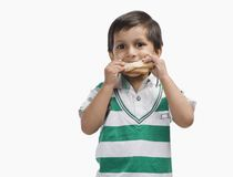 Boy eating bread royalty free stock images