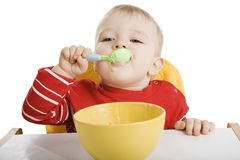 Boy eating breakfast Stock Photography
