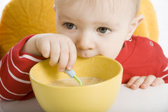 Boy eating breakfast Royalty Free Stock Photos