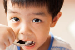 The boy is eating. Royalty Free Stock Image