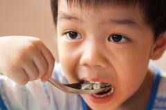 The boy is eating Royalty Free Stock Image