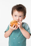 Boy eating a burger Royalty Free Stock Photography
