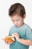 Boy eating a burger Royalty Free Stock Photo