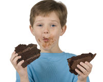 Boy Eating Cake Stock Photos