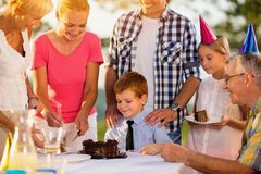 Boy eating cake at birthday party royalty free stock image