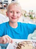 Boy eating a cake Stock Image
