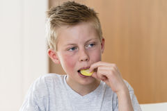 Boy eating candy Royalty Free Stock Photos