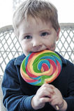 Boy eating candy Stock Image