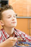 Boy eating cereal royalty free stock photos