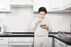 Boy eating cereal Royalty Free Stock Image