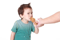 Boy eating chicken Royalty Free Stock Images