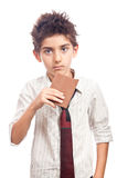 Boy eating chocolate Royalty Free Stock Images