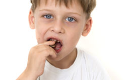 Boy eating chocolate Royalty Free Stock Photography