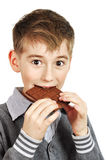 Boy Eating A chocolate bar Stock Images