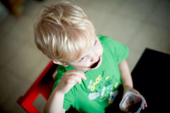 Boy eating chocolate pudding Stock Photo