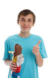 Boy eating chocolate rabbit Royalty Free Stock Image