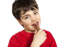 Boy eating a chocolate stick Royalty Free Stock Photo