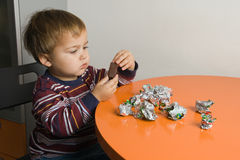 Boy eating chocolates Stock Photo