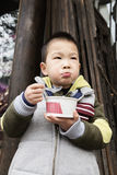 Boy eating congee Royalty Free Stock Photos