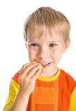Boy eating cookie Stock Photography