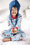 Boy eating cookies. Young boy in pajamas having cookies as a bedtime snack royalty free stock photography