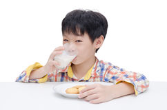 Boy eating cookies with milk Royalty Free Stock Photo