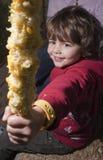 Boy eating corn. A Boy enjoying corn on the cob Royalty Free Stock Photos