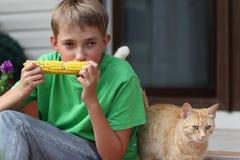 Boy eating corn. Boy eating fresh boiled corn Royalty Free Stock Images