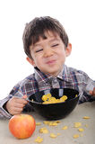 Boy is eating corn flakes Stock Photo