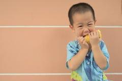 Boy eating corn Stock Image