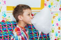 Boy eating cotton candy Royalty Free Stock Images