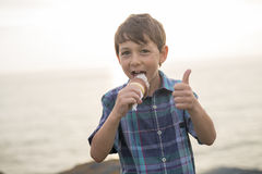 Boy eating a delicious ice cream on the sunset. Royalty Free Stock Photos