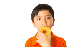 Boy eating a donut Stock Photo
