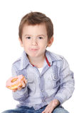 Boy eating a donut Royalty Free Stock Images