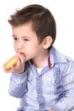 Boy eating a donut Royalty Free Stock Photos