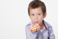 Boy eating a donut Stock Image