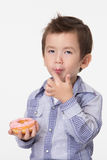 Boy eating a donut Stock Photos