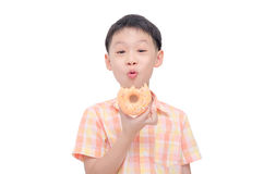 Boy eating donut over white Royalty Free Stock Photos