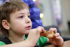Boy eating donut Royalty Free Stock Image
