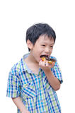 Boy eating donut Stock Photo